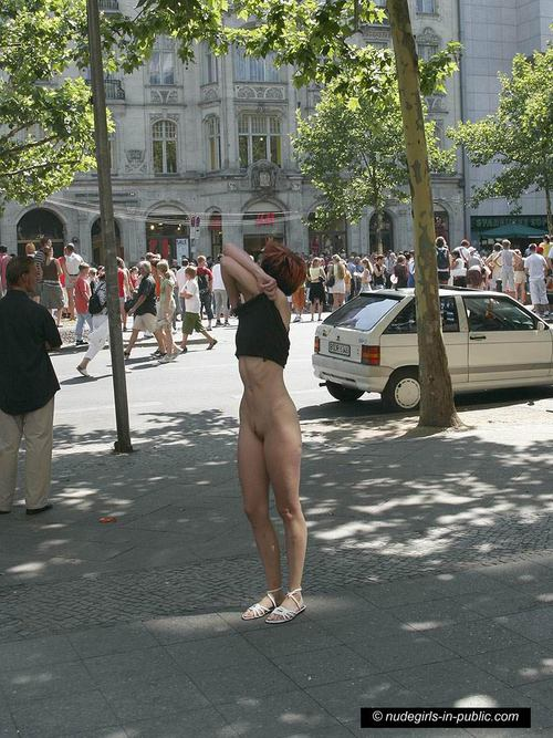 Woman running naked in streets video